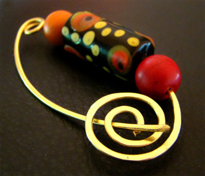 redlotusjewellery:  The Tribe Pin features an African glass bead handmade and handpainted in West Africa. Now available in my Etsy shop.