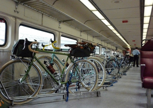 thegreenurbanist:  invaderjones:  fiend4bikes:  The Mythical MBTA Bike Train! (by Lovely Bicycle!)  Would this be so hard? What a fantastic idea!  Can we get this on Amtrak trains too please?!