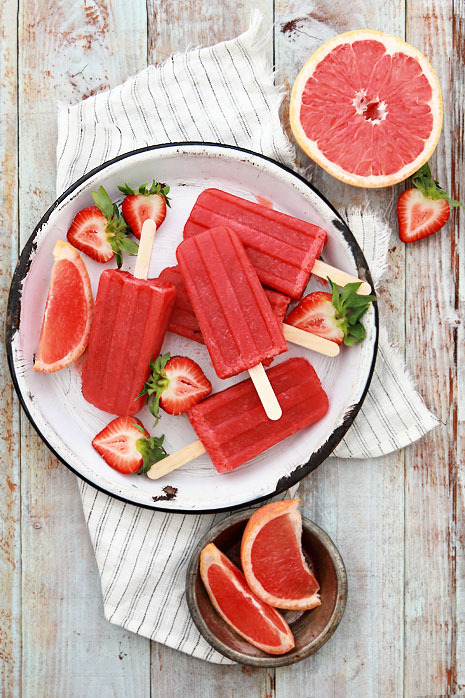 gastrogirl:  grapefruit and strawberry greyhound cocktail popsicles.  Me likes alcohol.  Me likes popsicles. Me loves alcohol popsicles.
