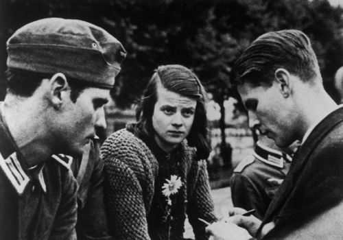 "itsjohnsen:  A 1942 photo of Hans Scholl, Sophie Scholl and Christoph Probst - members of the student resistance group, ""White Rose"". The group distributed pamphlets across Germany appealing to the public's sense of moral duty, calling for resistance to the Nazi dictatorship, and demanding an end to the war.  Sophie would be caught and reported to the Gestapo on the 18th of February, 1943 at Ludwig Maximilians University. All three would then be sentenced 5 days later and beheaded. George Witt"