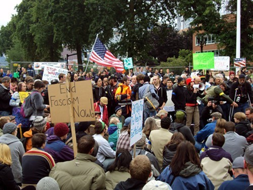 "Occupy Portland protesters target Hanford  About 150 Occupy Portland protesters went on a field trip to Washington state this weekend (April 13th, 14th and 15th) to protest nuclear war, nuclear energy and nuclear waste. RICHLAND, Wash. — About 150 Occupy Portland protesters went on a field trip to Washington state this weekend to protest nuclear war, nuclear energy and nuclear waste. They were visiting Richland, Wash., which is next to Hanford nuclear reservation. Activist Helen Caldicott says protesters wanted to visit ""the belly of the beast."" But the Tri-City Herald ( http://is.gd/zSGmE4) reports the protest also brought children, dogs, good food and the music of Portland bands to the sunny Sunday protest. Along George Washington Way, demonstrators in anti-contamination suits waved signs at passing traffic. A woman in a flowing cape and gas mask waved a rubber salmon and other people blew bubbles because, as their sign said, radiation travels through the air. Source"