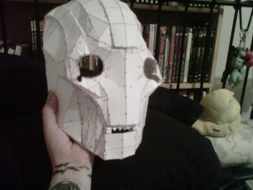 front of the head is pretty much done.  it's kind of wonky, but i can fix that once i start to reinforce it and whatever.  i'm going to start on the back tomorrow, yaaay.