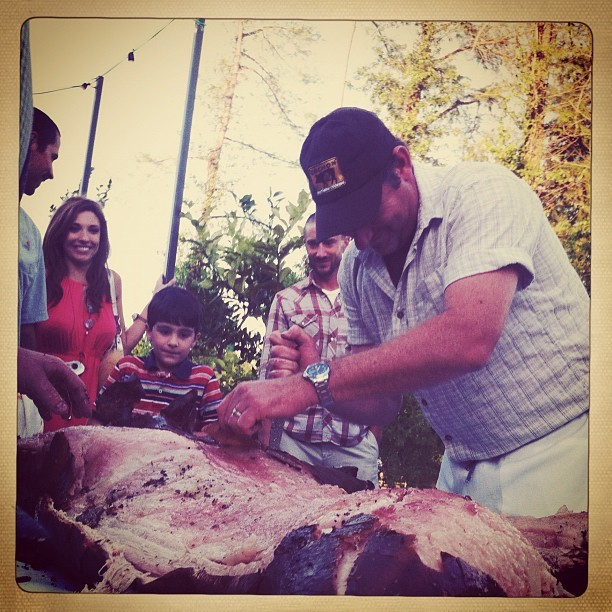 Donald Link carving a pig for a very happy crowd @ Cochon Lafayette (Taken with Instagram at Cochon Lafyette)