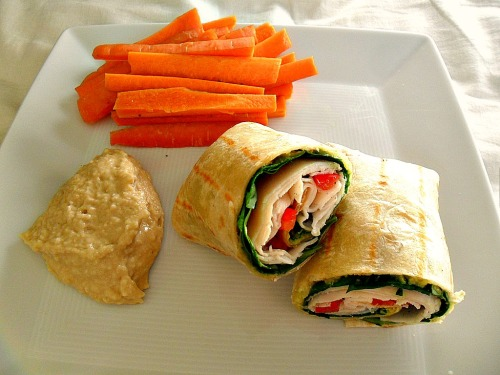 Grilled chicken and veggie wrap with carrots and hummus
