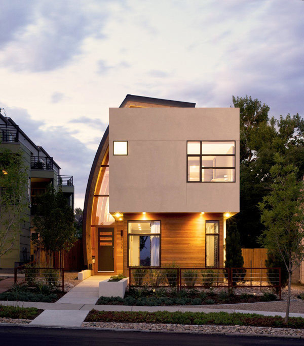 "arcilook:  Irregularly Shaped Modern Residence in Denver, Colorado: Shield House  Displaying an irregular exterior appearance, the Shield House designed by Studio H:T and located in Denver, Colorado, is a project that won our attention. According to the architects, ""this urban infill project juxtaposes a tall, slender curved circulation space against a rectangular living space. The tall curved metal wall was a result of bulk plane restrictions and the need to provide privacy from the public decks of the adjacent three story triplex. This element becomes the focus of the residence both visually and experientially. It acts as sun catcher that brings light down through the house from morning until early afternoon. At night it becomes a glowing, welcoming sail for visitors"". The unusual, but appealing exterior design elements are partially brought indoors with the help of wooden beams, some of them bended. Have a look and tell us what you think."