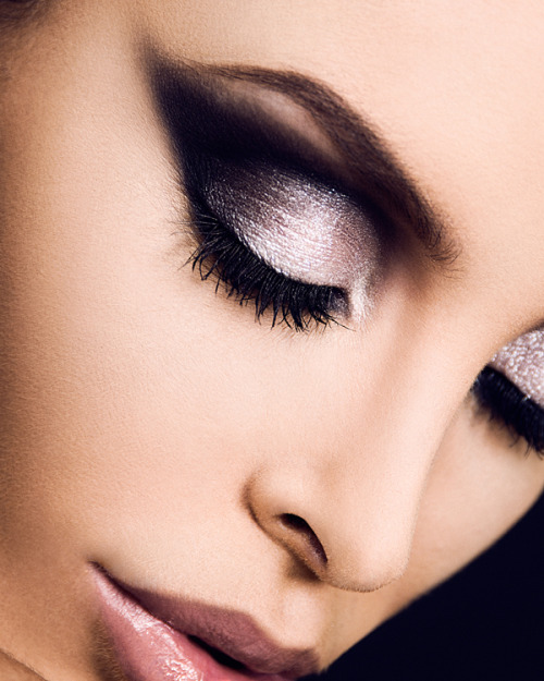 Darkness and Light: Black and White Shadow Look —- I might just do this myself! This is a simple, gorgeous look that's also incredibly dramatic because it pairs a deep dark matte black with a pearl-white. You can wear this even if you have an undefined crease as this shape follows the socket bone rather than the crease, but it's going to take some practice to make sure both eyes are even. DO: 1. Apply black pencil or gel liner as a base to lay down a shape first as you can clean up easily with a Q-tip and some makeup remover. This will also ensure that the black shadow goes on opaque, which is the key to this look. 2. Check if the white shadow you are using is very pigmented/opaque or quite sheer. If it is very sheer and shimmery, it's best to apply a white base underneath like NYX Jumbo Pencil in Milk. If it's quite opaque and strong, then it's ok to just use a flesh-colored or transparent primer. 3. Blend between the black and white shades slightly so you don't get a harsh cut-off line. Reverse-panda eyes are not cute. 4. Smoke out the edges of the black slightly so the lines are not harsh, but also don't over-blend as you don't want to end up with grey shadow or a Black Swan look. 5. Wear plenty of mascara. The black shadow is so strong that your lash line might just disappear otherwise.  —- [Photo source: eyeshadowlipstick.com]