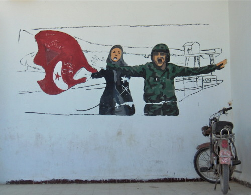 Mural on wall of the town's cultural centre, Im Layares, western Tunisia, April 2012 During the Tunisian revolution in 2011, the army refused to open fire on members of the public, helping to ensure the success of the revolution within a relatively short timeframe. The town's cultural centre has little going on right now, and no budget for events. With as many as one in three school or college-leavers unemployed, the town continues to experience tensions, despite the 605 new jobs recently announced at the state-owned phosphate works.