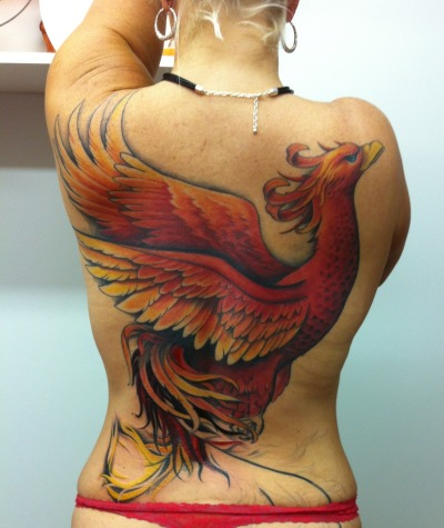 fuckyeahtattoos:  My Phoenix is fierce, strong, determined, and beautiful. It is me, reborn and reinvented as I enter and attack the second half of my life. Artist: Jessie Hopeless, Exile Tattoo, Kansas City, MO  omg, I want a phoenix tattoo like this!!! can someone draw me one in a circular design? pretty please?