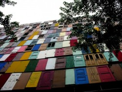 printedman:  Doors was an enormous 10-story public art installation made from 1,000 reused doors by South Korean artist Choi Jeong-Hwa. From what I can tell it appears the piece was installed somewhere in Seoul in 2009. Choi discusses his process over on the Creators Project where he talks about becoming a public installation artist because he was unable to draw or paint, but would instead spend much of his time walking around the city discovering interesting trash and discarded objects and photographing it. (via ju est fou)