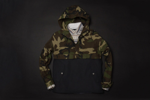 anchordivision:  Maiden Noir - Toutle Anorak Jacket Maiden Noir introduces a new camouflage outerwear menswear jacket for a mid-Spring/Summer 2012 delivery. A longtime favorite motif of the brand, the latest jacket option boasts a militaristic overtone via a dual camouflage and black exterior shell. The four-button front pairs alongside a heavy duty hood and two torso flap pockets. Buttoned cuffs, metal hardware, and a Japanese 60/40 nylon construction make the Maiden Noir Toutle Anorak Jacket the perfect fit for a spring outdoor trip. HAVEN now has stock with a retail of approximately $436 USD.   gimme