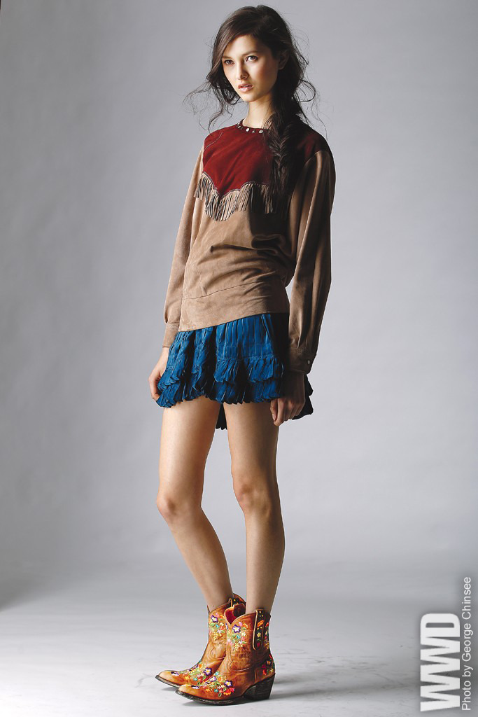 womensweardaily:  Fall 2012 Trend: South by Southwest Isabel Marant's suede top and silk skirt. Old Gringo boots.