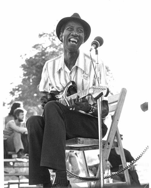 "Hound Dog Taylor 1915-1975Flesh, Bones, tons of soul From a guitarist point of view, having six fingers on your left hand is not a malformation, it's a gift. Hound Dog taylor was definitely gifted. He has pulled more bewildering slide blues and raw boogie than anyone ever did out of a Teisco. Hear him play ""Wild about you Baby"""