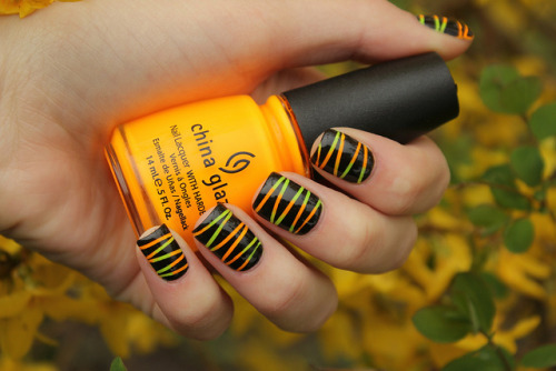 nailsbycoewless:  Yellow&Orange Neon Stripes on Flickr. Not as good as my first of this kind of manicure, but it's alright.  I don't like my nails at the moment.www.coewlesspolish.wordpress.com