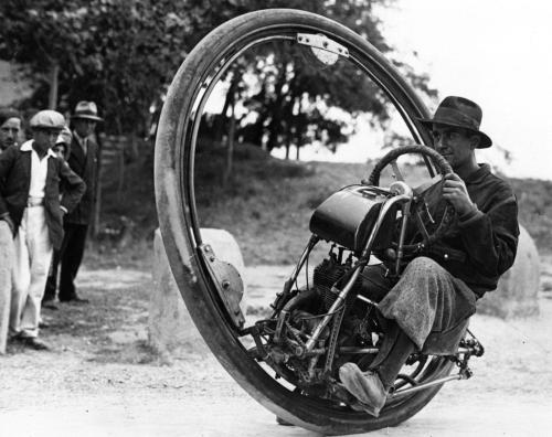 """Motorwheel"", a motorcycle with a wheel which runs on a rail placed inside a solid rubber tyre. 1931"
