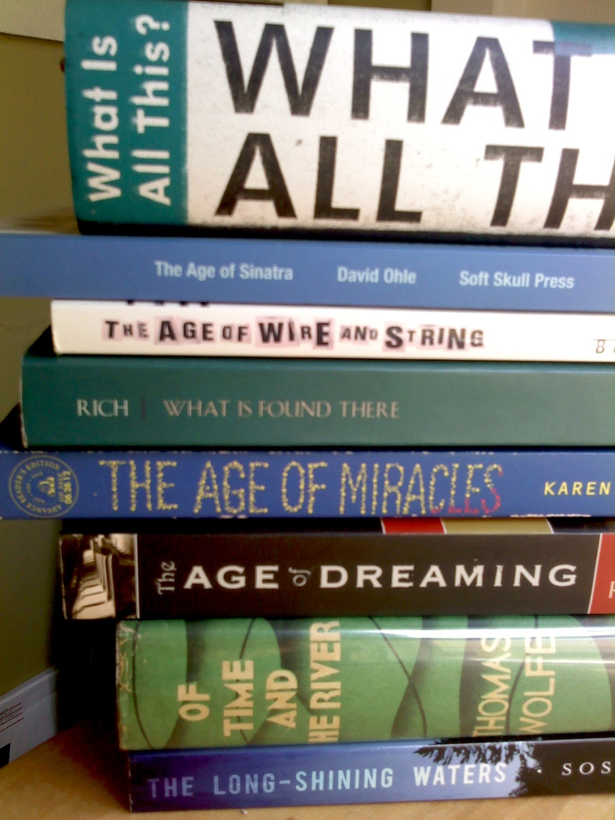 "prolixcorpuslibris:  An attempt at some book spine poetry of my own…  ""What is all this?"" What is all this? The age of Sinatra, The age of wire and string. What is found there? The age of miracles— The age of dreaming of time and the river, the long-shining waters."
