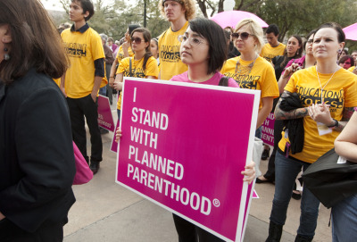"Planned Parenthood Branches Vote to Merge The boards of three regional Planned Parenthood branches — North Texas, Central Texas and the Capital Region — have voted to merge, forming a $29 million-per-year mega-organization with 26 clinics up and down the Interstate 35 corridor. The merger vote, in the works for more than a year, creates Planned Parenthood of Greater Texas, the eighth-largest affiliate of the nation's most ubiquitous reproductive health and abortion provider. ""The timing is right, in terms of looking ahead at the challenges we will face politically, and from a health care standpoint,"" said Leslie MacLean, board chairwoman of Planned Parenthood of North Texas. ""We felt like it was an obligation to look at all of the options to make us smarter and more efficient."""