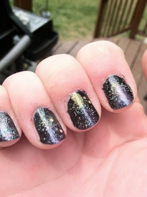 "Welp. This is a first attempt at the trend of ""Galaxy nails."" I think it looks pretty cool! The picture doesn't really show all the color demensions. Anywho. Just thought I would sharee : ) http://www.beautylish.com/a/vcyxy/galaxynailtutorial That's the tutorial I used :]"