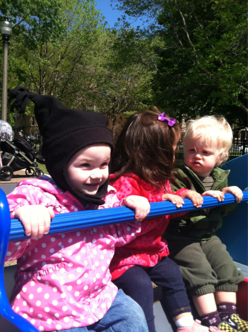 Riding the see saw with Violette at Welles Park.