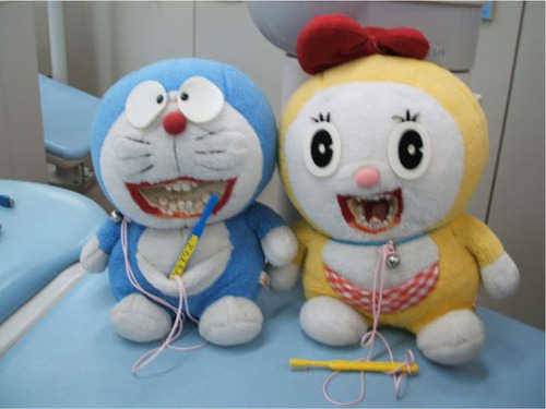 Doraemon here just wants to teach kids about brushing. Or feast on human flesh. I haven't decided yet.