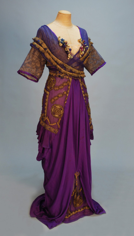 A wonderful bright purple evening gown from Lucile's Winter 1911 collection. If you're interested/independently wealthy, this dress is going up for auction on April 28th. The pre-auction estimate is $3,000-5,000. Who needs a car/apartment/college tuition when you could own a Lucile gown?! Although it is worth keeping in mind that the pre-auction estimate for this Lucile gown was $5,000-7,000. It will be interesting to see if this gown has similar results.