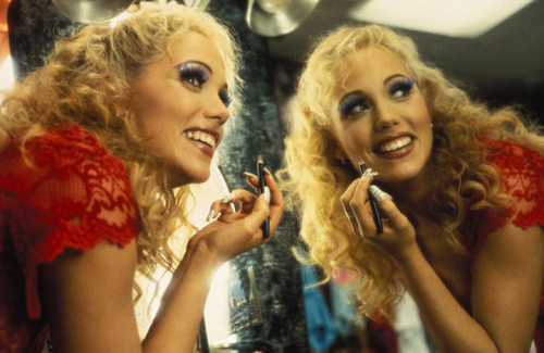 The Showgirls drinking game: any time you see boobs, butt, sex or Nomi Malone desperately eating a burger, DRINK
