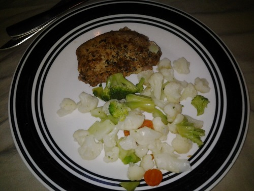Lunch. Leftover pork chop with steamed broccoli, carrots and cauliflower.