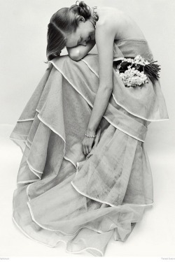 Dose of vintage: Model wearing a tiered evening dress, photographed by Norman Parkinson, March 1951.