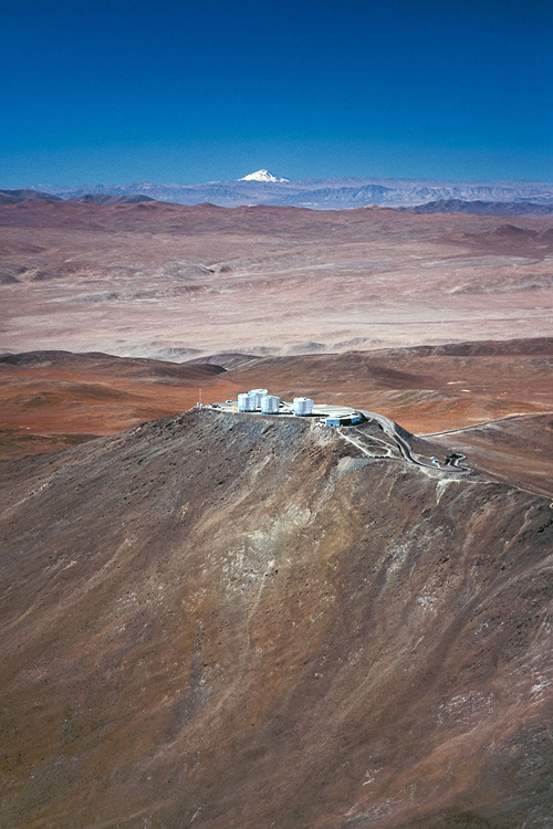 ckck:  Paranal Observatory in Chile, with the Llullaillaco volcano in the distance.   DESERTS