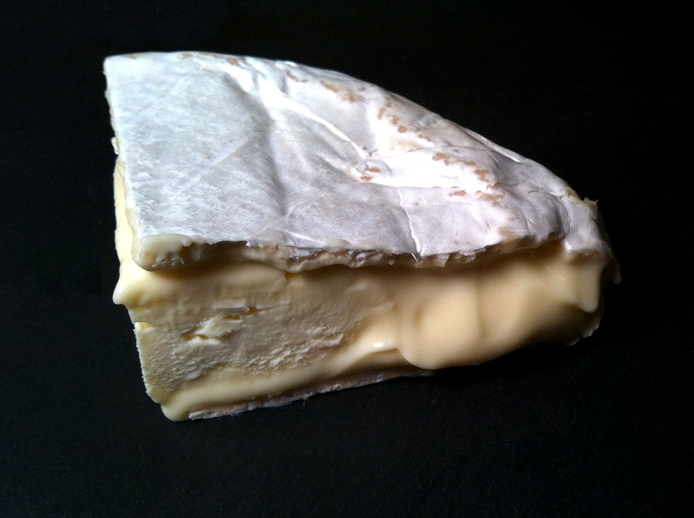 From the archives: Originally posted April 19th, 2012: Bent River Camembert, from the Alemar Cheese Company in Minnesota, is a cheese I've been on the prowl after for a while. I was curious to try this cheese after reading Janet Fletcher's review in the San Francisco Chronicle, but the last time I went looking for it, Lucy's Whey had already sold out and I couldn't find it at any of the other cheese mongers in town. Lucy's Whey recently tweeted that they had some, so I finally got my hands on a half wheel. Keith Adams, the maker behind Bent River, came to cheese making after years in the bagel business and prior to that as a stockbroker in San Francisco. Although a relative newcomer, he's obviously a quick study (you can read more about him here, from Minnesota Public Radio). This soft-ripened bloomy rind, inspired by the traditional Camembert de Normandie, is made from the milk of a local farm and a mix of Holstein, Normandy, Jersey, and Guernsey cows. With a luxuriant, velvety paste, buttery and smooth, in flavor it is milky and barnyardy but in a very subtle way, reminiscent of damp hay after a rain, with herbacous and floral hints and a full, mushroomy body.  It took a while to get my hands on, but it  was well worth the wait. Definitely a cheese to seek out.  Purchased at Lucy's Whey.