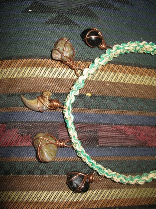 onyx, rhyolite, and bear claw woven hemp choker.  commission for linda.
