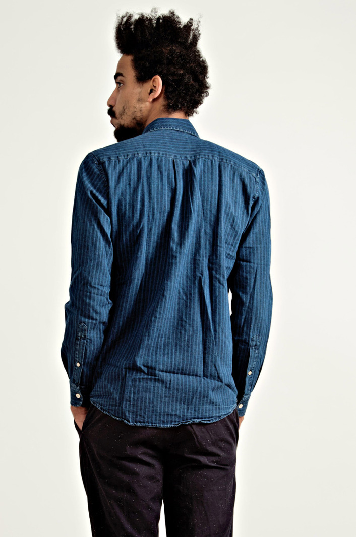 Our Legacy - Stripe Indigo Shirt The chambray train continues and Our Legacy has the update to the solid chambray. Shirt shown above is indigo dyed with tonal vertical stripes, slim fit and looks it looks well button-upped.  Available to purchase here.