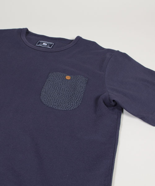 Penfield | Winthorp Vintage Pocket Tee This Penfield simple crew neck shirt features printed chest pocket and button closure. Shirt is Indigo dyed and also available in Grey Heather. Available to purchase here.