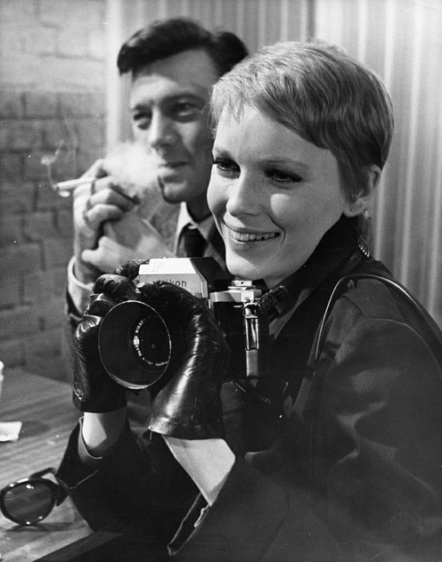"celebritycameraclub:  Mia Farrow with a Nikon Photomic F. Publicity photo from ""A Dandy in Aspic"" by Anthony Mann."