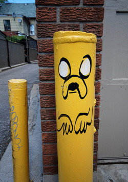 adventuretime:  Great Street Art of Jake the Dog on a Pole… … or greatest street art of Jake the Dog on a pole?