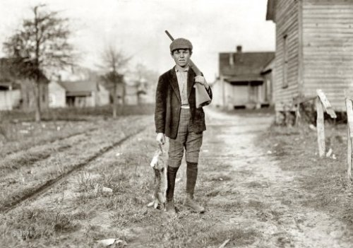 "December 1908 ~ Dillon, South Carolina, USA; ""Charley Baxley. Has doffed 4 years at Dillon Mills. Gets 50 cents a day. Had been out hunting."" Photograph and caption by Lewis Wickes Hine via"