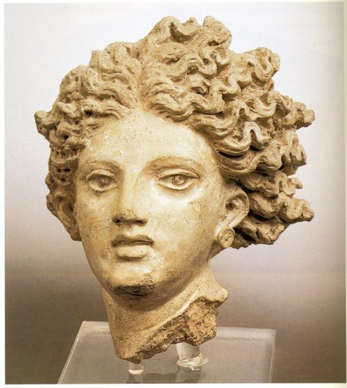 High-relief head of a young woman (Leukothea?) from the front pediment of Temple A at Pygi (Santa Severa), third quarter of the fourth century B.C., painted terra-cotta. Museo Etrusco di Villa Giulia, Rome