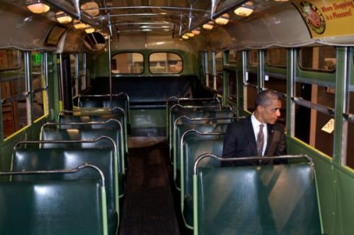 think-progress:  President Obama sits in Rosa Parks' bus 4/18/12   No doubt thinking about what it means that the Montgomery Civil Rights Museum has a replica of this bus while the original is in the Dearborn, MI Potemkin village built by Henry Ford, destroyer of mass transit.