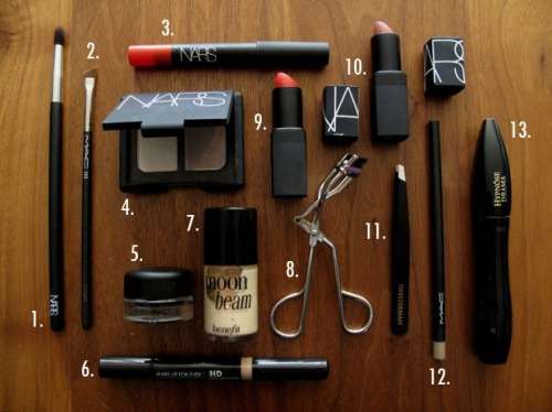 The Daily Face - April 19, 2012 - What's in My Makeup Bag I have a lot of makeup, it's no secret, but on a regular basis I actually wear very little.  I have a very small makeup bag (one of those silver lame zipper pouches from American Apparel), which fits everything I need for any occasion, formal, laid back, or even vacation.  This is a list of what I keep in that bag.  1. NARS Brush #12 2. MAC Brush #263 3. NARS Velvet Matte Lip Pencil in Jungle Red 4. NARS Eye Shadow Duo in Bellissima 5. MAC Fluidline in Blacktrack 6. Make Up For Ever HD Concealer in #225 7. Benefit Moon Beam 8. Tweezerman Eyelash Curler 9. NARS Semi Matte Lipstick in Heatwave 10. NARS Sheer Lipstick in Dolce Vita 11. Tweezerman Tweezers 12. MAC Eyebrow Pencil in Fling 13. Lancome Hypnose Drama Mascara