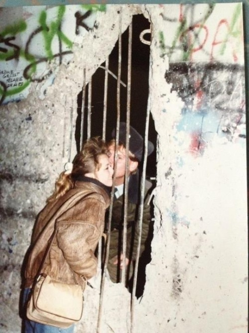 Sneaking a kiss through the Berlin Wall.