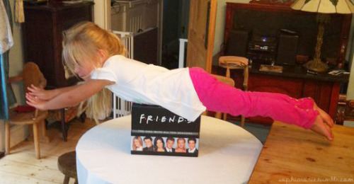 Rosie planking on a box set of FRIENDS……SAY WHAT!?!?!?