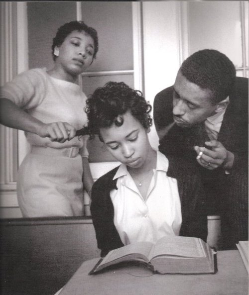 afterthesmoke:  Eve Arnold, School for black civil rights activists; young girl being trained to not react to smoke blown in her face, Virginia, 1960