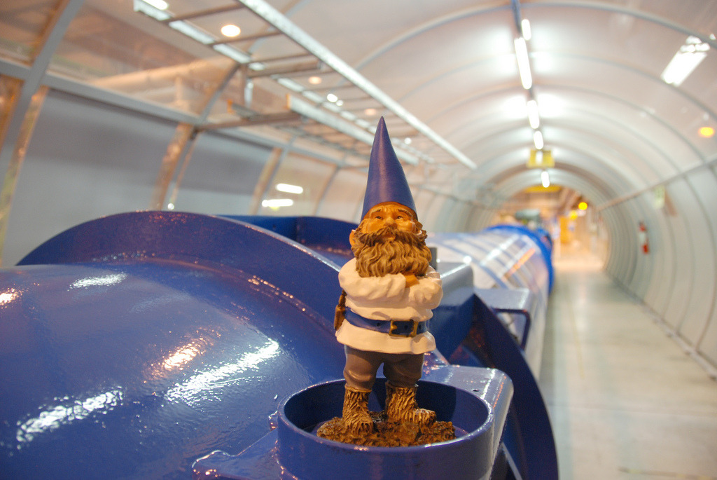 What is a Gnome Doing at the Large Hadron Collider? Meet Kern, the globe-traveling gnome. Here he is in one of the LHC's tunnels. Why? Are gnomes the secret to unlocking neutrinos? Kern is a project of Kern Precision Scales, a company that makes … you guessed it: Precision scales. See, gravity is slightly different at different places on the Earth's surface, which is where lumpy-Earth maps like this come from. That means you'd weigh slightly more or less at different spots on Earth. Kern the Gnome gets shipped all over the Earth where he is unpacked, weighed, photographed and finally sent to his next destination. He was heaviest at the South Pole, weighing 309.82 grams compared to Geneva's 307.65 grams. Follow Kern's travels on his Tumblr, or track him on Twitter or the project blog. (ᔥ Cocktail Party Physics)