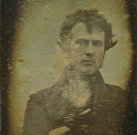 "A glimpse of the first photographic self-portrait by Robert Cornelius from 1839. Via fuckyeahhistorycrushes:    In 1839, a year after the first photo containing a human being was made, photography pioneer Robert Cornelius made the first ever portrait of a human being. On a sunny day in October, Robert Cornelius set up his camera in the back of his father's gas lamp-importing business on Chestnut Street in Center City, Philadelphia. After removing the lens cap, he sprinted into the frame, where he sat for more than a minute before covering up the lens. The picture he produced that day was the first photographic self-portrait. It is also widely considered the first successful photographic portrait of a human being. […] the words written on the back of the self-portrait, in Cornelius' own hand, said it all: ""The first light Picture ever taken. 1839."""