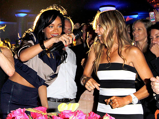 April 18: Rihanna passes the mic to Sheryl Crow during the 15th Annual 'An Unforgettable Evening' Benefiting EIF's Women's Cancer Research Fund in Beverly Hills, California.
