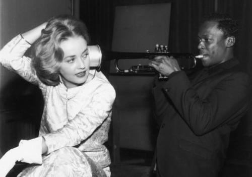 themafucage2:  Jeanne Moreau (French actress and singer) and Miles Davis France, 1958.