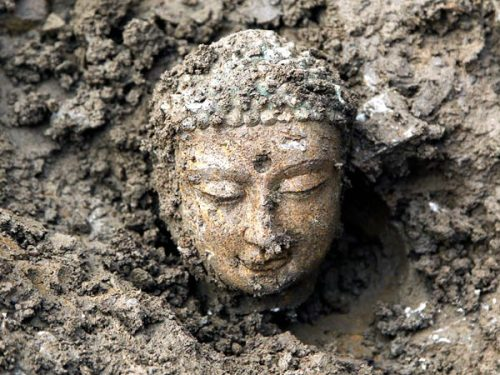 dendroica:   The head of a Buddha statue peeks above the dirt in Handan (map), China, where archaeologists have reportedly unearthed nearly 3,000 Buddha statues, which could be up to 1,500 years old. The discovery is believed to be the largest of its kind since the founding of the People's Republic of China in 1949, an archaeologist with the Chinese Academy of Social Sciences told reporters in late March, according to the Associated Press. The Buddha statues—most of which are made of white marble and limestone and many of which are broken—could date back to the Eastern Wei and Northern Qi dynasties (A.D. 534 to 577), experts say. The statues—discovered during a dig outside of Ye, the ancient capital of the Eastern Wei and Northern Qi dynasties—may have been rounded up and buried after the fall of the Northern Qi dynasty by later emperors in an attempt to purge the country of Buddhism.  (via Pictures: 3,000 Ancient Buddhas Unearthed in China)