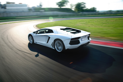 The Lamborghini Aventador is one mean beast By Basem Wasef on WIRED  From its jagged leading edge and faceted air intakes to the terraced-glass engine louvers and improbably angled tail, the Lamborghini Aventador LP 700-4 is one menacing machine. Its sharply creased body melds a series of striking sculptural shapes that bring to mind the venerable Countach and wicked Diablo. Beneath those angled creases lie all manner of bleeding-edge technology confirming the car's malicious intentions, including a carbon-fiber monocoque weighing just 325 pounds, Formula 1–inspired push-rod suspension and an ungodly powerful V-12 engine. How quickly the late, great Murcielago has become a low-slung relic. Lamborghini's new flagship is, in a word, nuts. Nothing else describes a 690-horsepower projectile that shoots from zero to 62 mph in 2.9 seconds. Yet Lamborghini has managed to build a 217-mph machine with surprisingly approachable handling. Don't get me wrong. The Aventador is still one mean beast. But it's a mean beast you can control, if not quite tame.