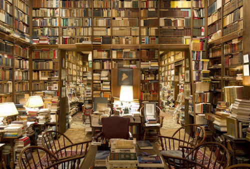 earth-is-like-an-apple:  This is not a library in shambles, no, its a STUDY!! You gotta a person who's study looks like this.
