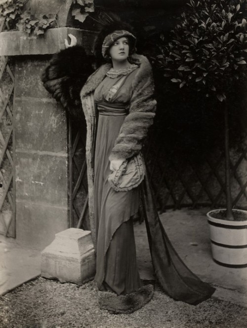 A Lucile model in a fur coat and high-waisted dress, circa 1912.