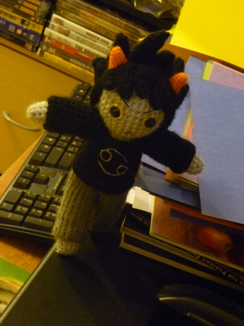 I haven't posted anything new in a while, so have a picture of Karkat running away from a photo shoot.